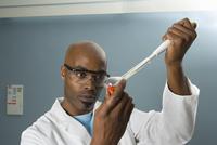 Technician measuring sample with pipette