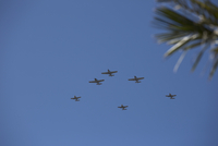 Low angle view of fighter planes against blue sky