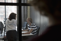 Man and woman talking with each other in office