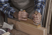 Man working in carpenter shop, close-up