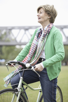 Mature woman cycling bicycle