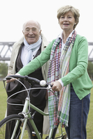 Couple standing with bicycle