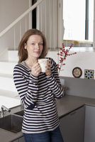 Woman holding coffee cup, portrait
