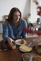 Woman having breakfast at dining table