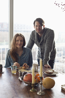 Couple having breakfast at dining table, portrait