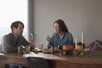 Couple having breakfast at dining table