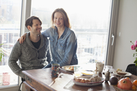 Couple sitting at dining table with breakfast