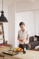 Woman cutting pumpkin at home
