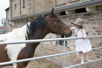 Girl embracing horse at farm