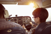Father and son in cockpit of private airplane