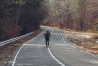 Hiker walking on country road