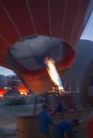 Men inflating hot-air balloon