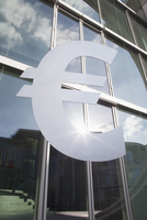 Low angle view of euro symbol outside office building