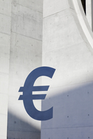 Euro symbol against concrete wall