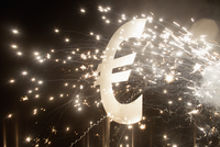 Euro symbol with fireworks at night