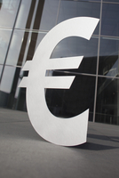 Euro symbol outside office building