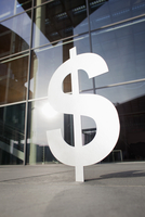Dollar sign outside office building
