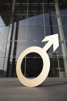 Male symbol outside office building