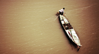 High angle view of man fishing on Mekong river, Cambodia