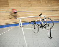 Bicycle hanging on rack at sports track