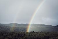 Rainbow over mountains against sky