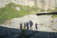 Shadow of friends on rock