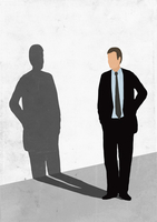 Illustration of businessman looking at his shadow on white wall