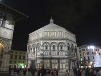 Tourists outside Florence Baptistery at night