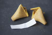 Broken fortune cookie on table