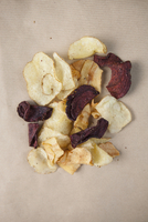 Directly above shot of potato and beetroot chips on table
