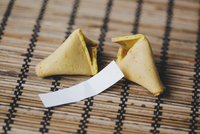 Broken fortune cookie on bamboo mat