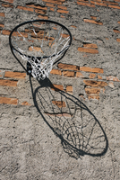 Low angle view of basketball hoop mounted on brick wall