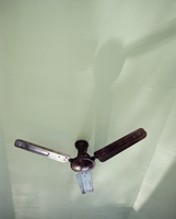 Low angle view of electric fan on ceiling