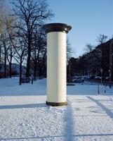 Column on snow covered landscape