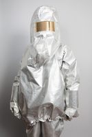 A person in a radioactive protection suit standing against a gray background 11016030864| 写真素材・ストックフォト・画像・イラスト素材|アマナイメージズ