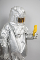 A person in a radiation protective suit holding a corn cob