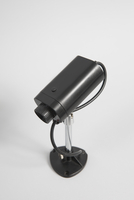 High angle view of security camera against white background