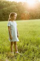 Full length of happy girl standing on grassy field