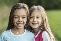 Portrait of girls smiling outdoors