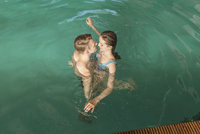 High angle view of passionate couple in swimming pool