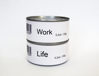 Work and Life printed on two tin cans, white background