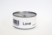 Love printed on label of tin can, white background
