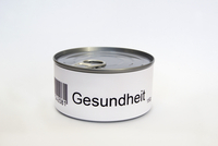 The German word for health, Gesundheit, on label of tin can, white background