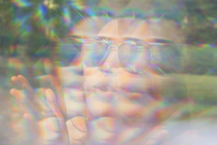 Reflection of woman on big bubble