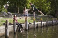 Happy friends enjoying by canal in park
