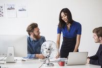 Business people communicating at desk in office