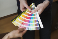 Midsection of business colleagues with color swatches in office