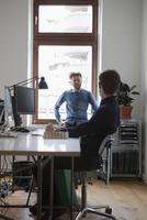 Businessmen communicating in office