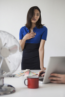Young businesswoman communicating at desk
