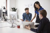 Multiethnic business people communicating at desk in office